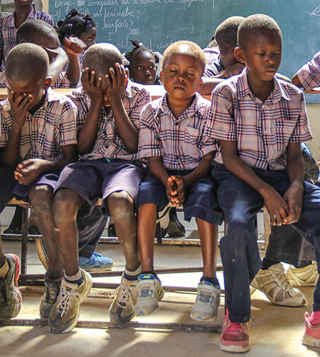 Students pray at the Dubuisson Christian school in Haiti