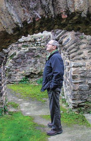 Arlin Hendrix surveys ruins of a Roman theater in Lyon.