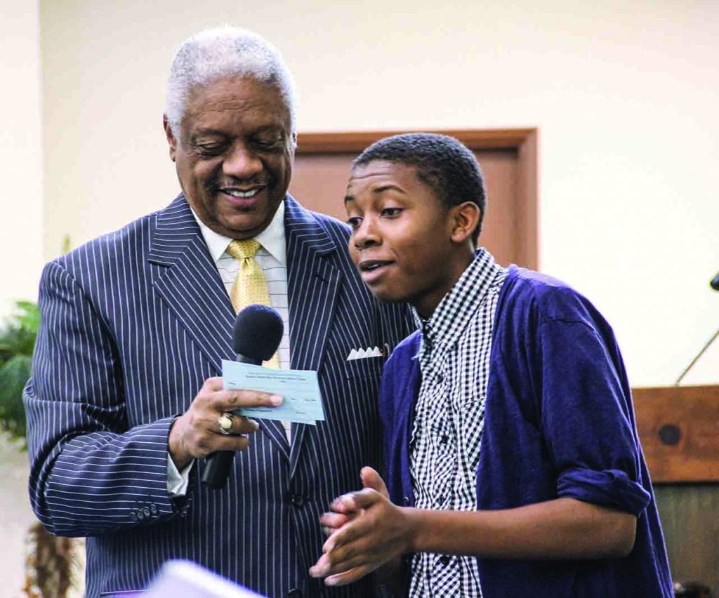 Billy C. Curl takes a prayer request from Lemuel Johnson on a Sunday morning in 2013.