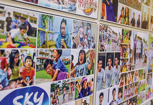Photos lining the walls show the history of the Moulmein church youth group