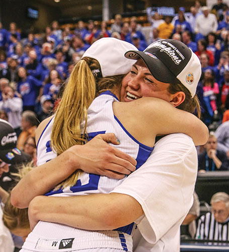 Caitlyn Buttram and Kellyn Schneider of Lubbock Christian University's Lady Chaparrals celebrate their NCAA Division II women's basketball championship after defeating Alaska-Anchorage in the national title game in Indianapolis. The 78-73 win capped an undefeated