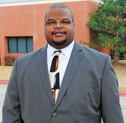 Conley Gibbs Jr. stands on the campus of Oklahoma Christian University
