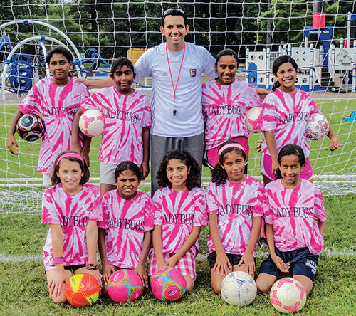 José 'Goyo' Nieto coaches youth league soccer as part of his community outreach.
