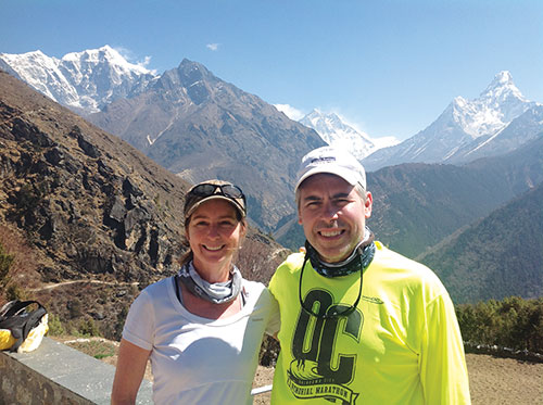 Valari and Greg Wedel stand at a camp in Nepal