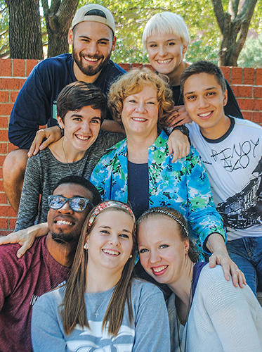 Nancy Hartman visits with a group of Third Culture Kids on campus in Oklahoma.