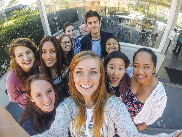 "Kelcy Nash takes a ""selfie"" with several students — from Australia and the U.S. — during a youth and young adults weekend retreat sponsored by the Southwest Church of Christ in Campbelltown"