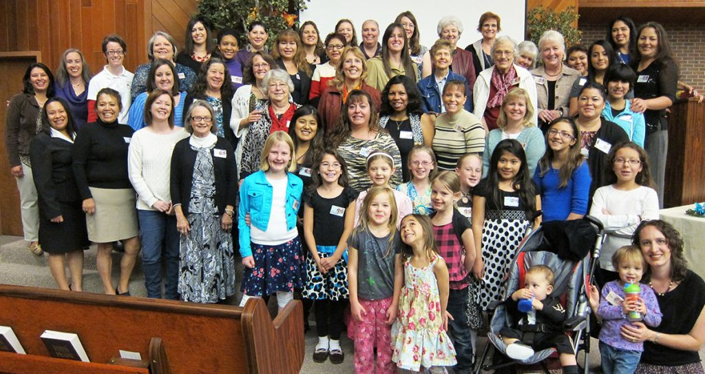 Participants pose for a photo during a ladies' event presented by Iron Rose Sister Ministries and hosted by the Northwest Church of Christ in Westminster