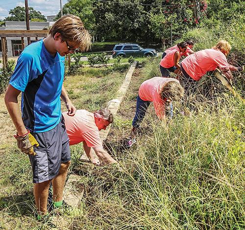 Faulkner University volunteers donate sweat as they serve in Montgomery