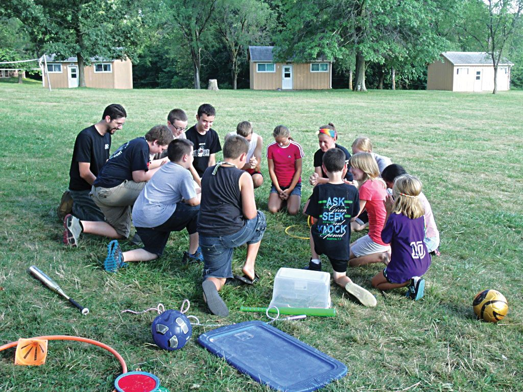 "Campers gather in a circle for some improvisational skits — in the style of the TV show ""Whose Line is it Anyway?"" — during the Midwest Bible Camp near Brighton"