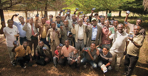 Preachers in Ethiopia hold up solar-powered audio players they received from Sunset International Bible Institute in Lubbock