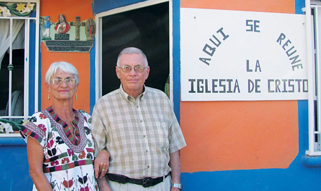 Judy and Jim Taylor stand outside the meeting place of the Villa Union Church of Christ