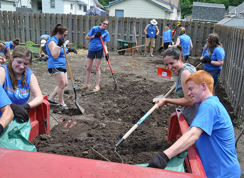 SoulQuest teens work on a garden project during the annual camp at York.