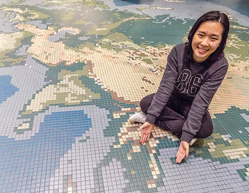 Thao Pham points to her home nation