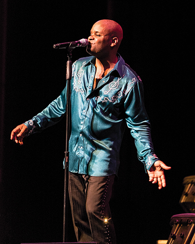 Theron Denson performs as Black Diamond at a March 2015 concert in Clinton