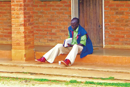 A student reviews class material at Mzuzu Bible College in Malawi's Northern Region.