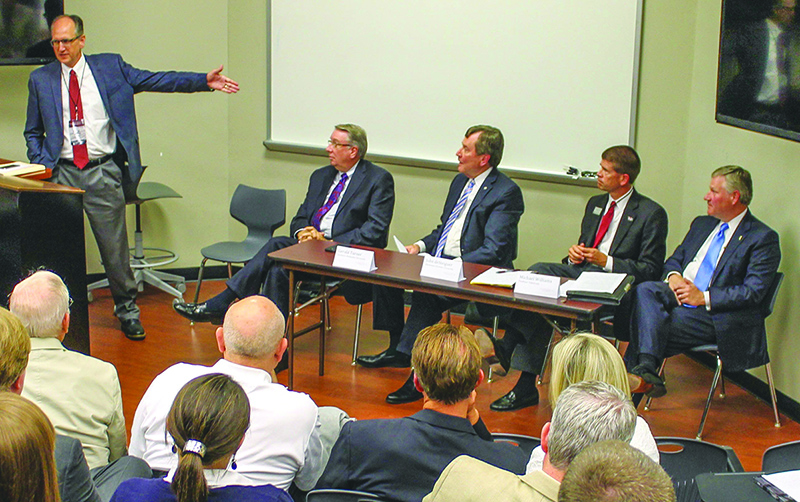 Lubbock Christian President Tim Perrin moderates a panel discussion with Lipscomb President Randy Lowry