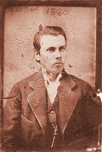 A daguerreotype (an early photograph produced on a silver-covered copper plate) shows J.D. Tant at age 19