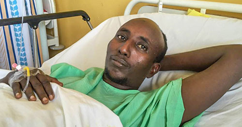 Salah Sabdow Farah talks to reporters in a Kenyan hospital just before his death.