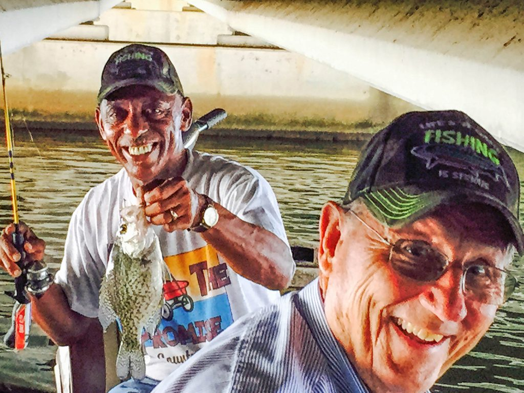 Clarence Sanders and Raymond Climer smile during a recent fishing trip.