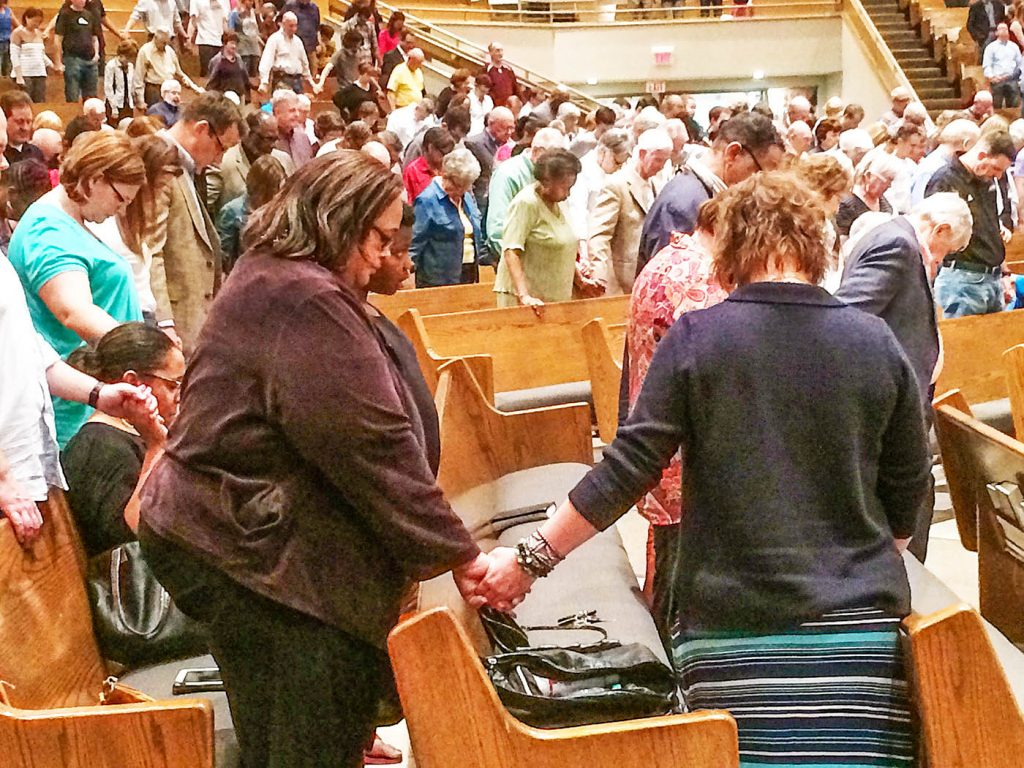 "Christians pray during a ""United in Christ"" Sunday evening service in Oklahoma City."