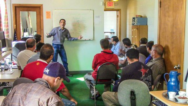 Wissam Al-Aethawi preaches the Gospel to an audience of recent Arab immigrants in Dearborn