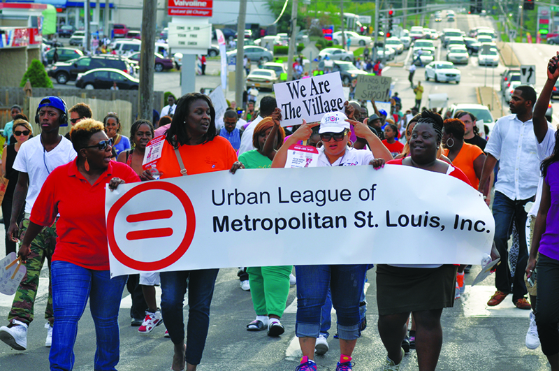 Protesters march in Ferguson