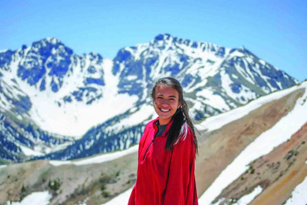 Hannah Mae Gigstad (standing in front of the San Juan Mountains in Colorado) hopes to study geology in college.