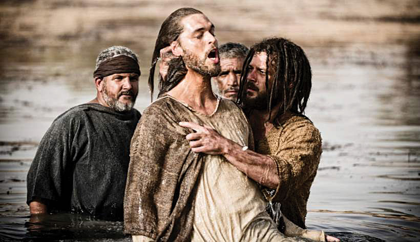 "John the Baptist (Daniel Percival) baptizes Jesus (Diogo Morgado) in ""Son of God.""  The film"