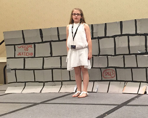 Reese Akins performing in the 3-6th grade drama event.