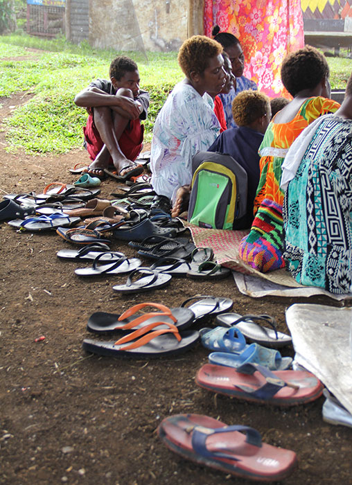 Church members remove their sandals before Sunday worship at the Etas Church of Christ in Vanuatu.