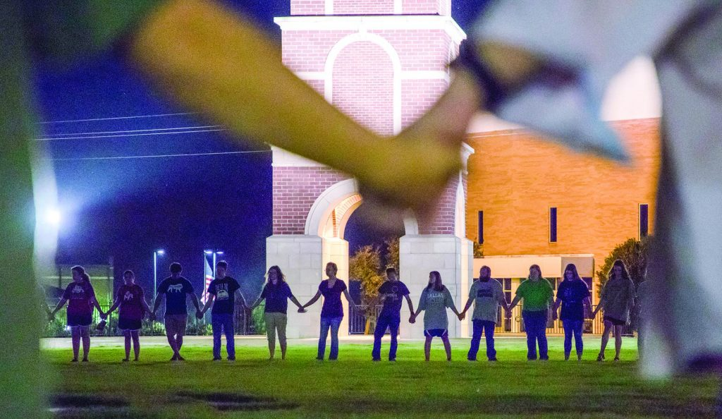 Students at Freed-Hardemann University in Henderson, Tenn., gather for a special prayer after a mass shooting targeted the Burnette Chapel Church of Christ. The attack left one member dead and seven others wounded.