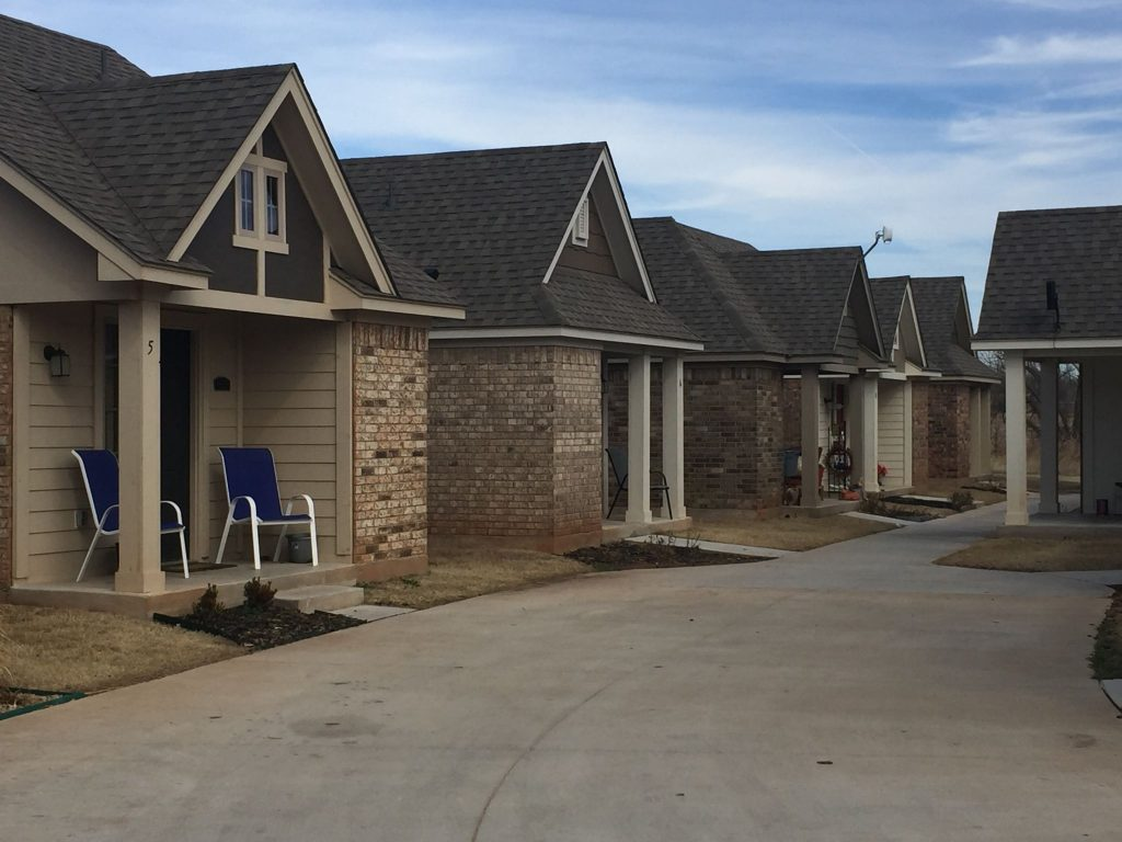 A row of houses built to help the homeless community in Norman, Okla.