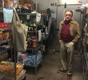 Gene McKown stands inside the food pantry at McKown Village. The pantry provides food to those in need.