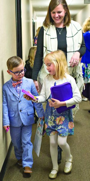 Drew Hathaway and sister Harper are dressed up for the Southpoint Church of Christ's first Sunday morning assembly at the Red Bridge Road building. Their mother, Karen Hathaway, walks behind them.