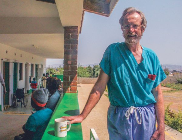 Bob Whittaker takes a quick break during a busy day at the Mathangeni clinic in 2017.