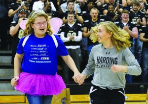Alissa Carter, left, and volleyball player Taylor Lake at the Make-A-Wish reveal celebration at Harding University.