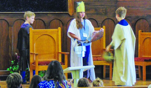 """Children perform a biblical skit during the """"Revive Us Again"""" worshop."""