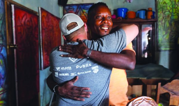 A Haitian man hugs Cody Kemp, a missions committee member from the North Atlanta Church of Christ, and thanks him for a water well drilled by Healing Hands.