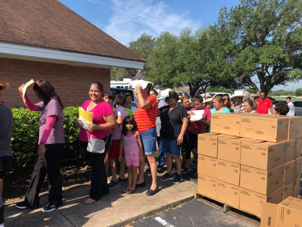 Flood victims line up to receive help at the Bridge Avenue Church of Christ in Weslaco, Texas.