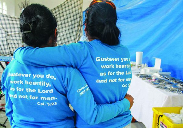 Health Talents dental assistants take a rest between patients, sporting the ministry's pun-laden T-shirts that celebrate the 10th anniversary of Clinica Caris, a facility near Chichicastenango that serves Guatemala's Quiché department.