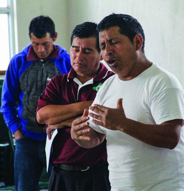 Church deacon Sebastian Salvador Yacon leads a prayer as the clinic begins.