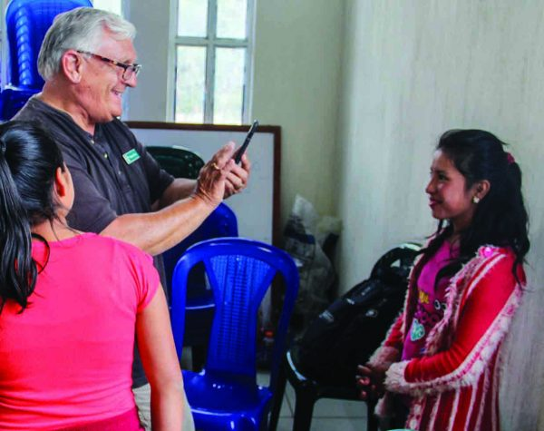 """Brother Dave"" Mellor of Health Talents takes a video of a girl in the ministry's ABC child sponsorship program. About 800 ""ABC kids"" receive food, clothing and school fees. The children must stay in school and worship with a Church of Christ."