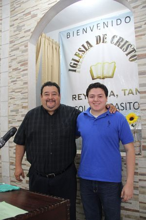 Mateo Dimas, minister for the Iglesia de Cristo Lampasitos, and his son.
