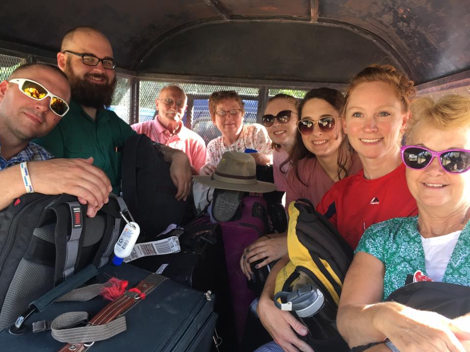 Members of the mission team smile for a picture as they travel during their work in Haiti.