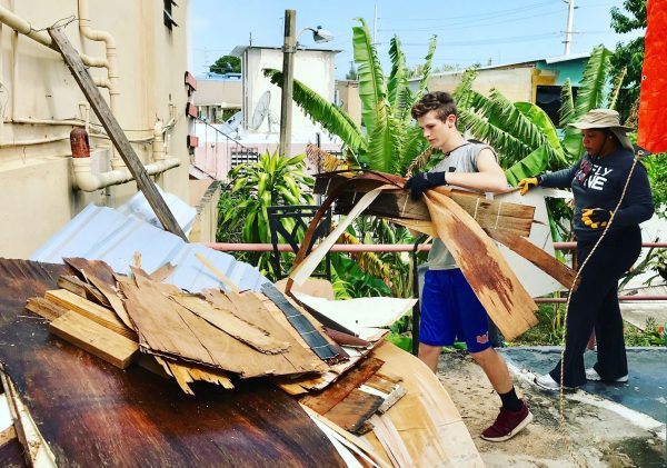 Carter Space and Charidy Dobbins remove debris from the Arecibo, Puerto Rico, home of Annea Soto, a victim of Hurricane Maria.