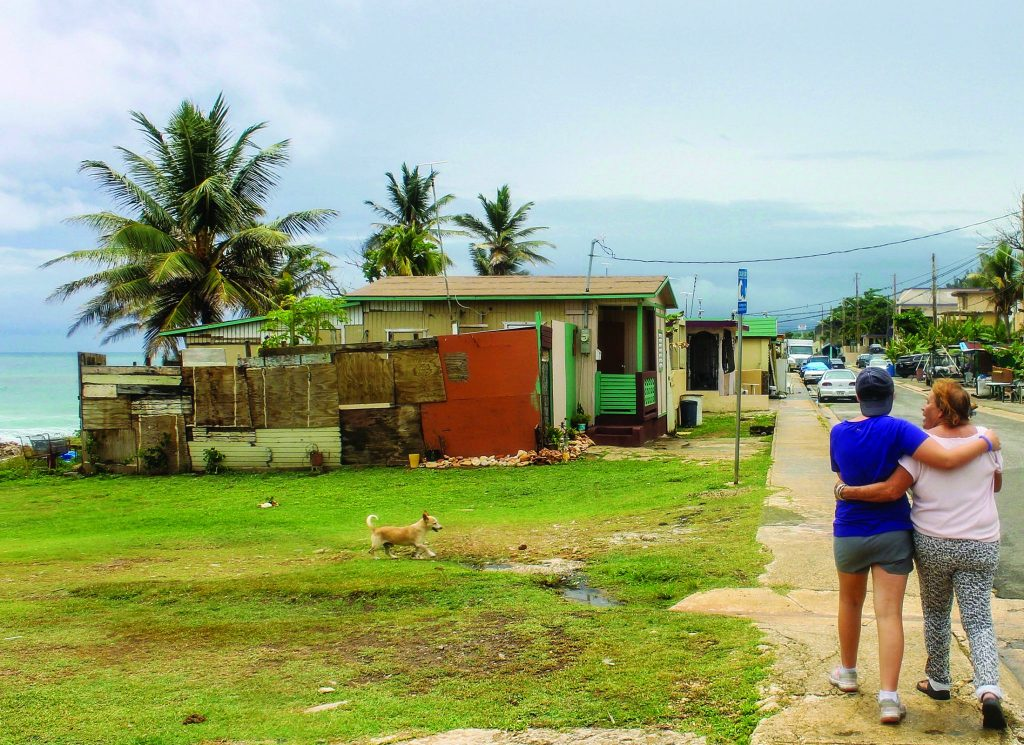 Ashton Brophy, 13, visits with Sandra Rosa Vargas, a Hurricane Maria victim who lives in Arecibo, Puerto Rico.