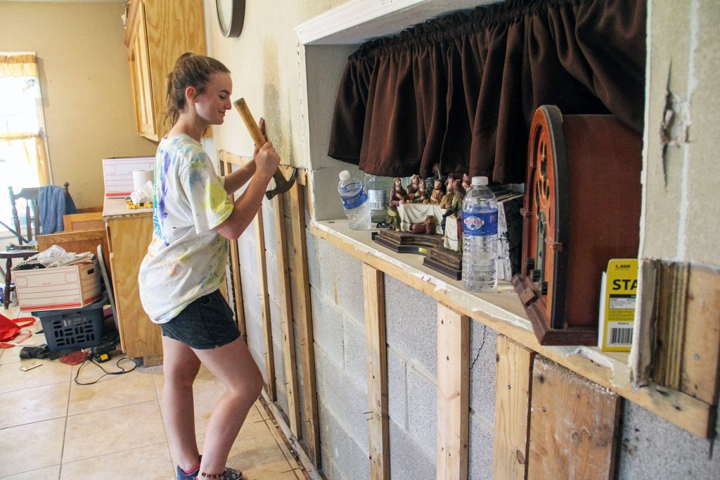Jaci Palmer, 16, a member of the First Street Church of Christ in Lampasas, Texas, removes damaged drywall from a home in Weslaco after severe flooding.