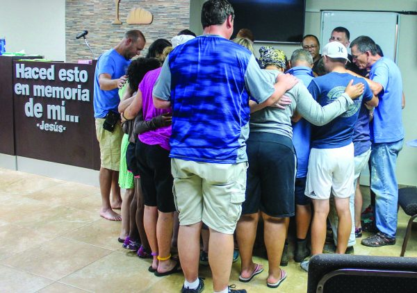 The mission team from the Reidland Church of Christ in Paducah, Ky., prays with Puerto Rican brothers and sisters at the Arecibo Church of Christ.