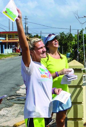 Carson McKee and Tristen Goodman invite Arecibo residents to a church carnival.