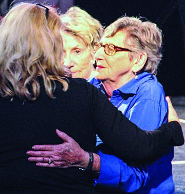 After a Sunday evening prayer in Allen Arena, Summer Celebration participants hug members of Burnette Chapel.